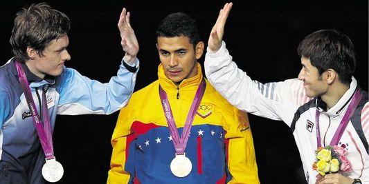 1741531_3_7cd2_premier-medaille-olympique-du-venezuela-en_7cd0e8ea1d95792f298565876edef6df