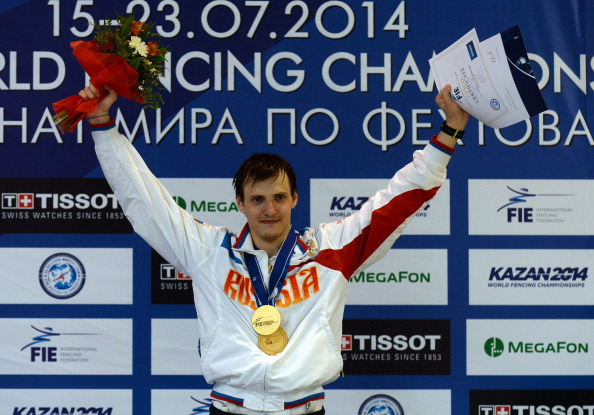 Alexey Cheremisinov of Russia poses with his gold medal at the men's Individual Foil final match at the 2014 World Fencing Championships in Kazan, on July 19, 2014. AFP PHOTO / VASILY MAXIMOV (Photo credit should read VASILY MAXIMOV/AFP/Getty Images)